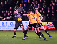 Lincoln City's Harry Anderson vies for possession with Cambridge United's Jake Carroll, left, and Brad Halliday<br /> <br /> Photographer Andrew Vaughan/CameraSport<br /> <br /> The EFL Sky Bet League Two - Cambridge United v Lincoln City - Saturday 29th December 2018  - Abbey Stadium - Cambridge<br /> <br /> World Copyright © 2018 CameraSport. All rights reserved. 43 Linden Ave. Countesthorpe. Leicester. England. LE8 5PG - Tel: +44 (0) 116 277 4147 - admin@camerasport.com - www.camerasport.com