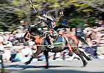 "Dressed in ornate period costume, a member of the Toyama-ryu ""yabusame"" horseback archery group takes aim at a target during a yabusame ritual in Machida, western Tokyo, Japan on Nov. 28 2010. During the late Heian era (794 to 1185) and Kamakura era (1185-1333) such mounted archery was the domain of high-ranked samurai and was used as a military training exercise to keep samurai prepared for war. .Photographer: Robert Gilhooly"