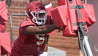 NWA Democrat-Gazette/J.T. WAMPLER Dorian Gerald runs tackling drills Monday August 6, 2018 during practice at the University of Arkansas in Fayetteville.
