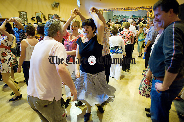 Dancing to the Kilfenora Ceili Band in the local hall at a set dancing session during the Dan Furey Weekend at Labasheeda. Photograph  by John Kelly.