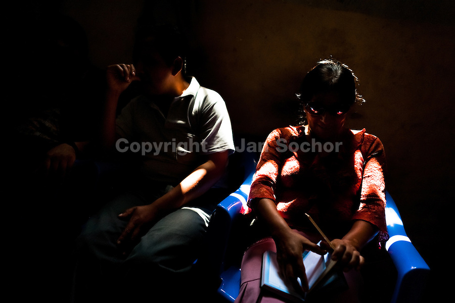 Blind people relax in the changing room of Unión Nacional de Ciegos del Perú, a social club for the visually impaired in Lima, Peru, 5 April 2013. Unión Nacional de Ciegos del Perú, one of the first societies for disabled in Latin America, was established in 1931 to provide a daily service for blind and partially sighted people from the capital city. The range of activities includes reading books in a large Braille library, playing chess or using a computer adapted for visually impaired individuals. As the majority of the blind does not have a regular job, the UNCP club offers them an opportunity to learn and lately, to provide massages to the club visitors and thus generate some income.