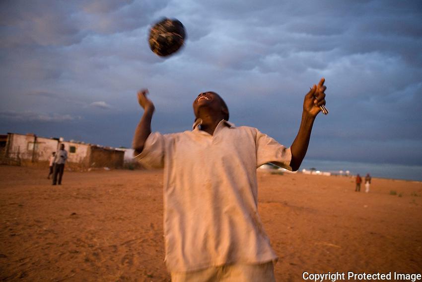 Osire Camp, Namibia. Kids playing football.
