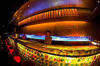 Colorfully lit bar of the TMSK Restaurant in the Xin Tian Di entertainment district, Shanghai, China