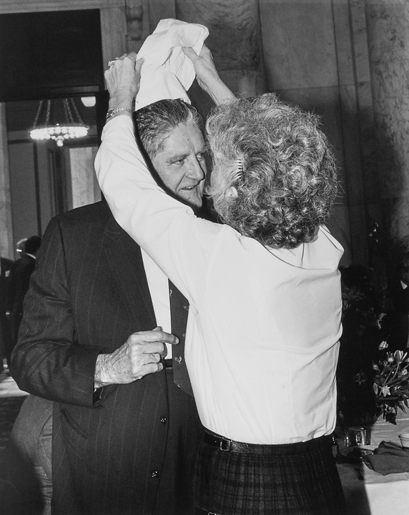 Mrs. Peatsy Hollings helps Sen. Howell Heflin, D-Ala. put on chef hat donated to him by National Restaurant Association on April 18, 1991. (Photo by Laura Patterson/CQ Roll Call)