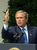 United States President George W. Bush holds a full press conference in the Rose Garden of the White House in Washington, DC on July 30, 2003.  He took questions for almost an hour on a variety of questions including Iraq, tax cuts, and the upcoming election.<br /> Credit: Ron Sachs / CNP