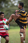 Tofaga Iese fails to secure the ball from a high kick. Counties Manukau Premier Club Rugby game between Bombay and Karaka, played at Bombay, on Saturday March 15 2014. Karaka won the game 39 - 12 after leading 13 - 5 at halftime.  Photo by Richard Spranger