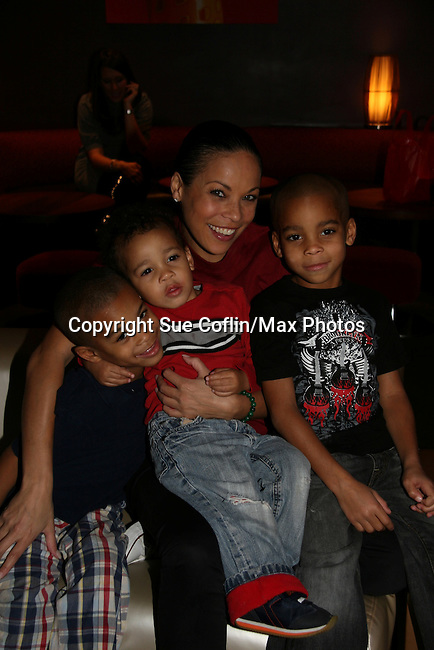 One Life To Live's Daphnee Duplaix & kids twins Sebastian (L), and Jaylen (R) and other son Jaxson (middle) at the 2009 Daytime Stars and Strikes to benefit the American Cancer Society to benefit the American Cancer Society on October 11, 2009 at the Port Authority Leisure Lanes, New York City, New York. (Photo by Sue Coflin/Max Photos)