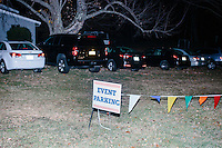 Flags and a sign indicate the parking area while Republican presidential candidate and former Florida governor Jeb Bush speaks to a crowd in the barn of Dr. and Mrs. James Betti in Rye, New Hampshire, for former Massachusetts senator Scott Brown's No B.S. BBQ series.