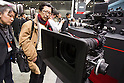 February 9, 2012, Yokohama, Japan - Visitors look at the Canon EOS C300 digital cine camera at the CP+ Camera and Photo Imaging Show 2012. The event is held from February 9-12. (Photo by Christopher Jue/AFLO)
