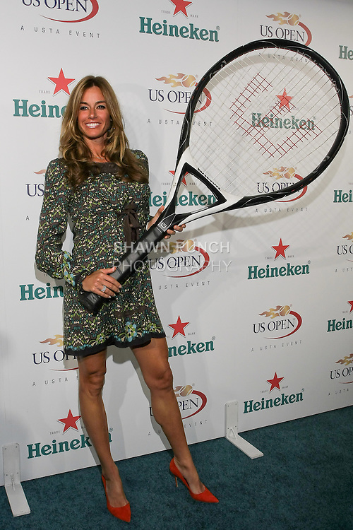 Kelly Killoren Bensimon plays with oversized tennis racket at the US Open Player Party at The Empire Hotel, August 27, 2010.