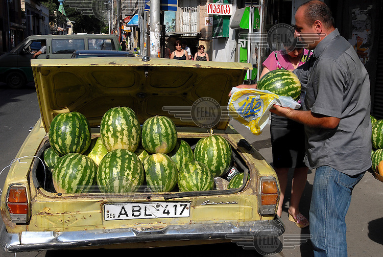 Man selling watermelons from the back of his car in central Tbilisi.