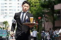 "May 22, 2016, Tokyo, Japan - A waiter carries a glass of beer on a tray during the ""garcon carry race"" in Tokyo on Sunday, May 22, 2016 as a  part of ""Aperitif 365"" event. 46 contestants from restaurants and cafes participated the beer carry race vying for the first prize of 300,000 yen, sponsored by French beer Kronenbourg.  (Photo by Yoshio Tsunoda/AFLO) LWX -ytd-"