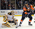 Jan 15, 2009; Uniondale, NY, USA; Boston Bruins goaltender Tim Thomas (30) stops New York Islanders rightwing Bill Guerin (13) at the Nassau Coliseum. Mandatory Credit: Tomasso DeRosa/SportPics