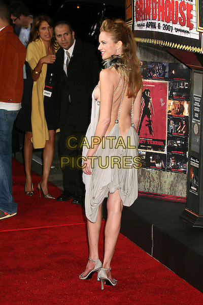 "LAURA CAYOUETTE.""Grindhouse"" Los Angeles Premiere at the Orpheum Theatre, Los Angeles, California, USA, 26 March 2007..full length back behind backless dress reveling skin no underwear bum rear grey.CAP/ADM/BP.©Byron Purvis/AdMedia/Capital Pictures."