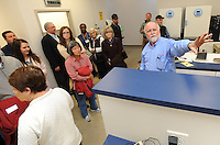 NWA Democrat-Gazette/ANDY SHUPE<br /> Gordon Whitbeck (right), president and microbiologist of Whitbeck Labs in Springdale, leads a tour Wednesday, Jan. 18, 2017, at the newly constructed office and laboratory for the longtime poultry testing company in Springdale during a grand opening celebration.