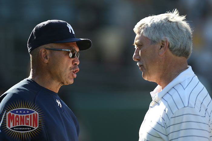 OAKLAND, CA - JULY 5:  Oakland Athletics television broadcaster and former player Ray Fosse (right) talks with former teammate and New York Yankees special assistant Reggie Jackson during batting practice before the game against between the New York Yankees and Oakland Athletics at the Oakland-Alameda County Coliseum on July 5, 2010 in Oakland, California. Photo by Brad Mangin