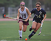 Jennifer Medjid #20 of Garden City, left, gets pressured by Daniella Specht #14 of Baldwin during a Nassau County Conference I varsity field hockey match at Garden City High School on Friday, Sept. 30, 2016. Garden City won by a score of 7-0.