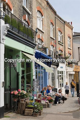 Primrose Hill. Regents Park Road shops and cafe. London UK 2008