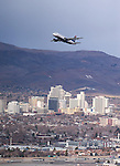 Planes fly out of Reno-Tahoe International Airport in Reno, Nev., on Friday, Dec. 19, 2014.<br /> Photo by Cathleen Allison