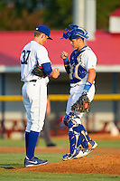 Burlington Royals catcher Chase Vallot (8) fist bumps relief pitcher Eric Sandness (37) during the game against the Greeneville Astros at Burlington Athletic Park on June 30, 2014 in Burlington, North Carolina.  The Royals defeated the Astros 9-8. (Brian Westerholt/Four Seam Images)