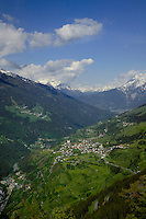 View of forests and snow capped mountains overlooking the river Inn and town of Fliess. Kaunerberg, Tyrol/Tirol, Austria.