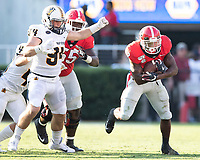ATHENS, GA - SEPTEMBER 7: Zamir White #3 pulls away from Murray State defender Austin Hogancamp #94 during a game between Murray State Racers and University of Georgia Bulldogs at Sanford Stadium on September 7, 2019 in Athens, Georgia.