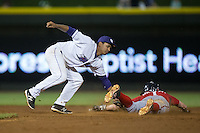 Andrew Stevenson (1) of the Potomac Nationals is tagged out by Winston-Salem Dash shortstop Cleuluis Rondon (13) as he is caught stealing at BB&T Ballpark on May 13, 2016 in Winston-Salem, North Carolina.  The Dash defeated the Nationals 5-4 in 11 innings.  (Brian Westerholt/Four Seam Images)