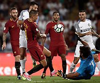 Calcio, Serie A: Roma, stadio Olimpico, 26 agosto, 2017.<br /> Inter's Antonio Candreva (l) in action with Roma's Aleksandar Kolarov (c) and Alisson (r) during the Italian Serie A football match between Roma and Inter at Rome's Olympic stadium, AUGUST 26, 2017.<br /> UPDATE IMAGES PRESS/Isabella Bonotto