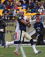 Rutgers defensive back Brandon Jones (in white) breaks up a pass intended for Pitt wide receiver Devin Street (15). The Pitt Panthers defeat the Rutgers Scarlet Knights 27-6 on Saturday, November 24, 2012 at Heinz Field , Pittsburgh, PA.