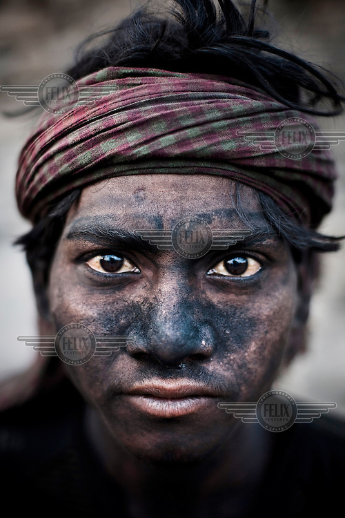 Govinda Bhuia works for about 10 hours a day, earning 150 Indian Rupees (3.5USD), loading coal trucks in the BCCL (Bharat Coking Coal Limited) coal mines.