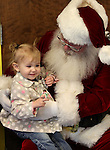 Elle Bingham, 2, sits with Santa during Storytime at the Carson City Library on Thursday, Dec. 13, 2012. .Photo by Cathleen Allison