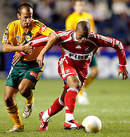 LA Galaxy midfielder Peter Vagenas (8) tries to slow down Chicago Fire forward Andy Herron (26).  The Chicago Fire defeated the Los Angeles Galaxy 3-1 in the championship game of the U.S. Open Cup at Toyota Park in Bridgeview, IL on September 27, 2006...