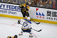 June 12, 2019: Boston Bruins left wing Brad Marchand (63) looks for a lane by St. Louis Blues left wing David Perron (57) during game 7 of the NHL Stanley Cup Finals between the St Louis Blues and the Boston Bruins held at TD Garden, in Boston, Mass.  The Saint Louis Blues defeat the Boston Bruins 4-1 in game 7 to win the 2019 Stanley Cup Championship.  Eric Canha/CSM.