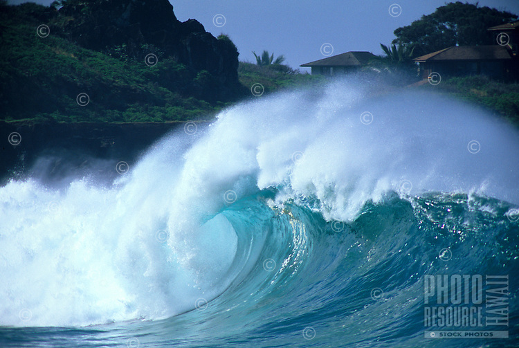 Big winter shore break at Waimea Bay on the north shore of Oahu.