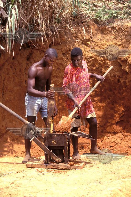 © Giacomo Pirozzi / Panos Pictures..CAMEROON..Men making mud bricks.
