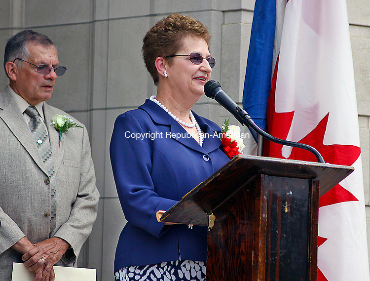 WATERBURY CT.-24  JUNE 2010-062410DA01- Franco-American Mayor for a Day, Jeanne LaPrade of Waterbury addresses a crowd with her husband Brent behind her during a ceremony held at the Chase building in Waterbury Thursday morning.<br /> Republican-American Darlene Douty