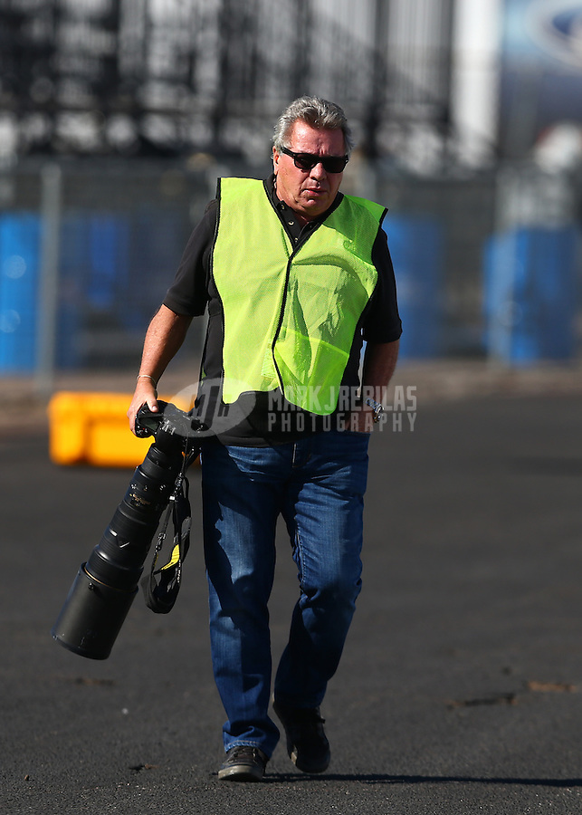 Feb 4, 2016; Chandler, AZ, USA; NHRA photographer Richard Shute during pre season testing at Wild Horse Pass Motorsports Park. Mandatory Credit: Mark J. Rebilas-USA TODAY Sports