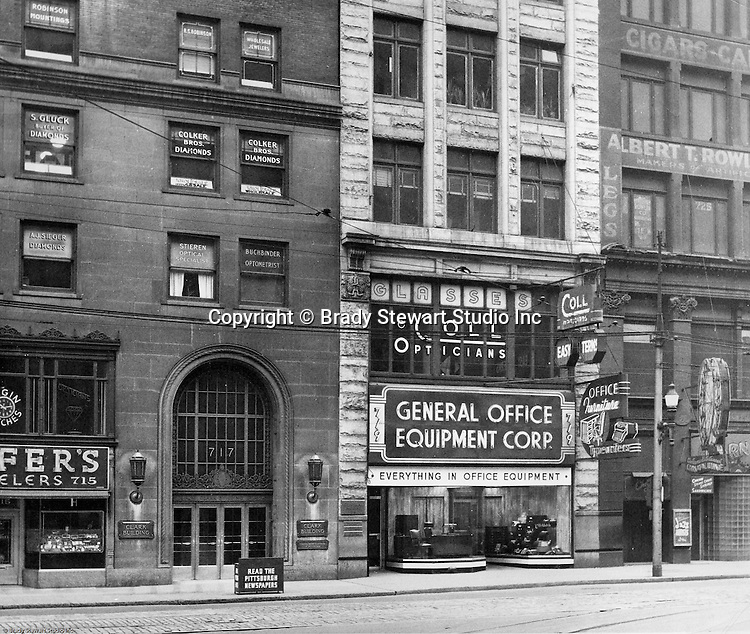 Pittsburgh PA:  View of the 700 block of Liberty Avenue from Wood Street - 1953.  View includes the Clark Building 717 Liberty, General Office Equipment 719 Liberty and the Carnival Lounge at 725 Liberty.  Brady Stewart Studio moved into 725 Liberty Avenue (4th Floor) a year later. Nearby businesses included; Helfer's Jewelers, Dimling's Candies, Cole Optical, McFarren Typewriters, Equitable Gas Company, Iben and Irr Department Store and Max Azen's.