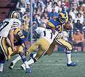 Los Angeles Rams Lawrence McCutcheon(30) in action during a game New Orleans Saints. Lawrence McCutcheon played for 11 years  with 4 different teams and was a 5-time Pro Bowler.David Durochik/SportPics