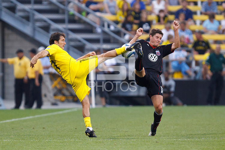 26 JUNE 2010:  Guillermo Barros Schelotto of the Columbus Crew (7)  and Chris Pontius #13 of DC United  during MLS soccer game between DC United vs Columbus Crew at Crew Stadium in Columbus, Ohio on May 29, 2010. The Crew defeated DC United 2-0.