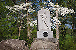 Gettysburg National Military Park, PA<br /> Flowering dogwood and spring forest backing a monument to Michigan's soldiers
