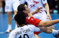 05 APR 2012 - LONDON, GBR - Tunisia's Issam Tej (TUN) (right) tangles with South Korea's Chan-Yong Park (KOR) during the men's 2012 London Cup match at the National Sports Centre in Crystal Palace, Great Britain (PHOTO (C) 2012 NIGEL FARROW)