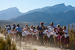 Riders are supported by local school children during stage three of the 2010 Absa Cape Epic Mountain Bike stage race from Ceres to Ceres in the Western Cape, South Africa on the 23 March 2010.Photo by Karin Schermbrucker/SPORTZPICS