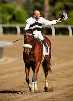 Mike Smith celebrates as he wins his 5000 race, aboard Amazombie in the 2012 Potrero Grande Stakes at Santa Anita Park in Arcadia California on April 7, 2012.
