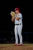 Vancouver Canadians relief pitcher Luke Gillingham (17) looks to his catcher for the sign during a Northwest League game against the Tri-City Dust Devils at Gesa Stadium on August 21, 2019 in Pasco, Washington. Vancouver defeated Tri-City 1-0. (Zachary Lucy/Four Seam Images)