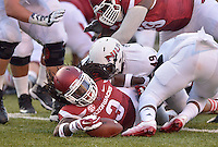 STAFF PHOTO BEN GOFF  @NWABenGoff -- 09/20/14 <br /> Arkansas running back Alex Collins holds onto the ball after it popped out on the tackle by Northern Illinois defensive end Jason Meehan during the first quarter of the game against Northern Illinois in Reynolds Razorback Stadium in Fayetteville on Saturday September 20, 2014.