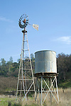 Beat-up Aermotor windmill and water tank in the foothills of the Coast Range, Calif.