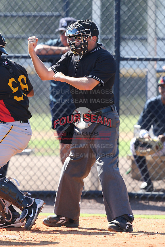 Home plate umpire Jansen Visconti during a game between the New York Yankees and Pittsburgh Pirates in an Instructional League game at the New York Yankees Minor League Complex in Tampa, Florida;  October 8, 2010.  Photo By Mike Janes/Four Seam Images