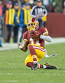 Washington Redskins wide receiver DeSean Jackson (11) slides after making a long reception in first quarter action against the Philadelphia Eagles   at FedEx Field in Landover, Maryland on Saturday, December 20, 2014.<br /> Credit: Ron Sachs / CNP