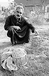 Shatila, near the sports city of Beirut. A Syrian of palestinian origin survives by selling birds captured in the wild.<br />  <br /> Chatila, proche de la cit&eacute; sportive. Un syrien d'origine palestinienne survit gr&acirc;ce &agrave; la vente d'oiseaux captur&eacute;s dans la nature.